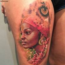 awesome-african-female-and-lion-eye-tattoo